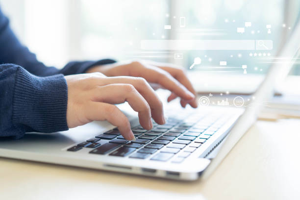close up woman hand type on keyboard laptop to use search engine optimization (seo) tools for finding customer or promote and advertise about content online for marketing technology and business concept - big tech foto e immagini stock