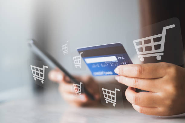 Close up woman hand using phone and credit card for online shopping and payment concept stock photo