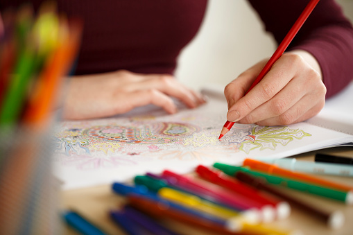 Close Up Woman Hands Coloring An Adult Coloring Book