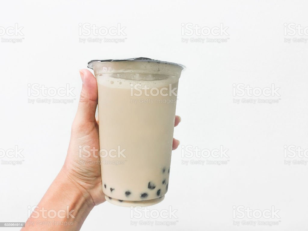 Close up woman holding iced coffee with bubble tea stock photo