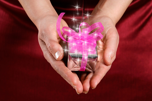 Close up woman holding little gift box