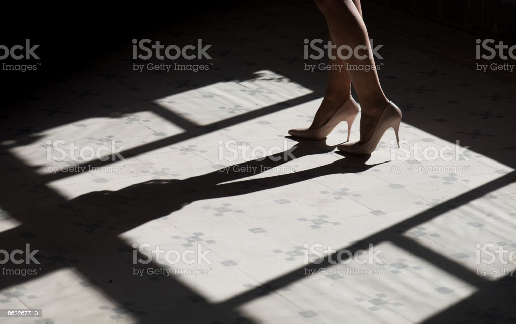 Close up woman legs in high heels stock photo