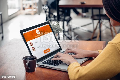 861940002 istock photo Close up woman sitting and shopping online on laptop computer in add to cart function webpage at coffee shop,Digital marketing concept.digital lifestyle living 946799498