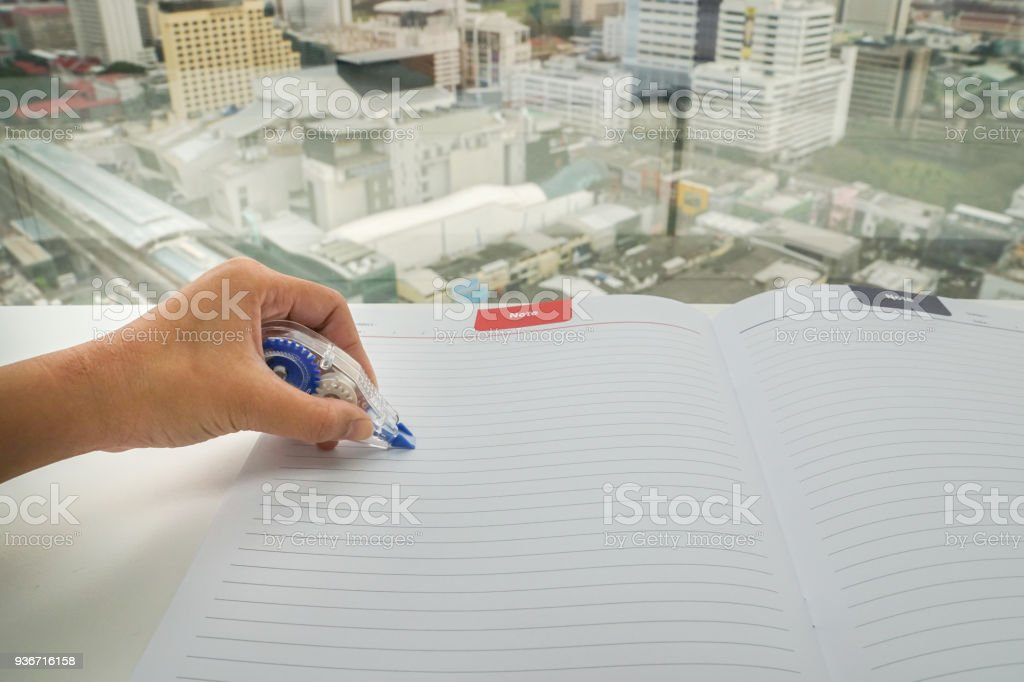 close up woman uses 3 on mock up paper sheet for mistake removal stock photo