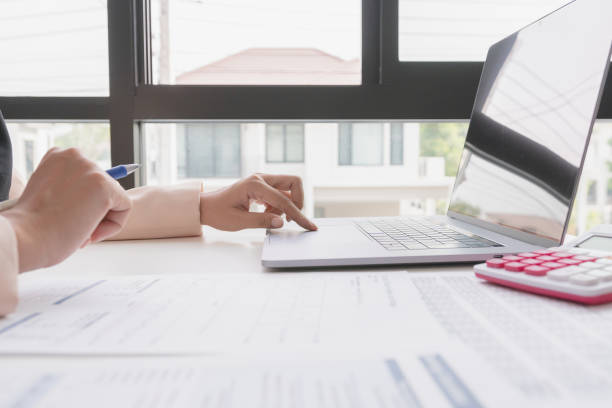 close up woman working at home office hand on laptop. - privacy policy stock photos and pictures