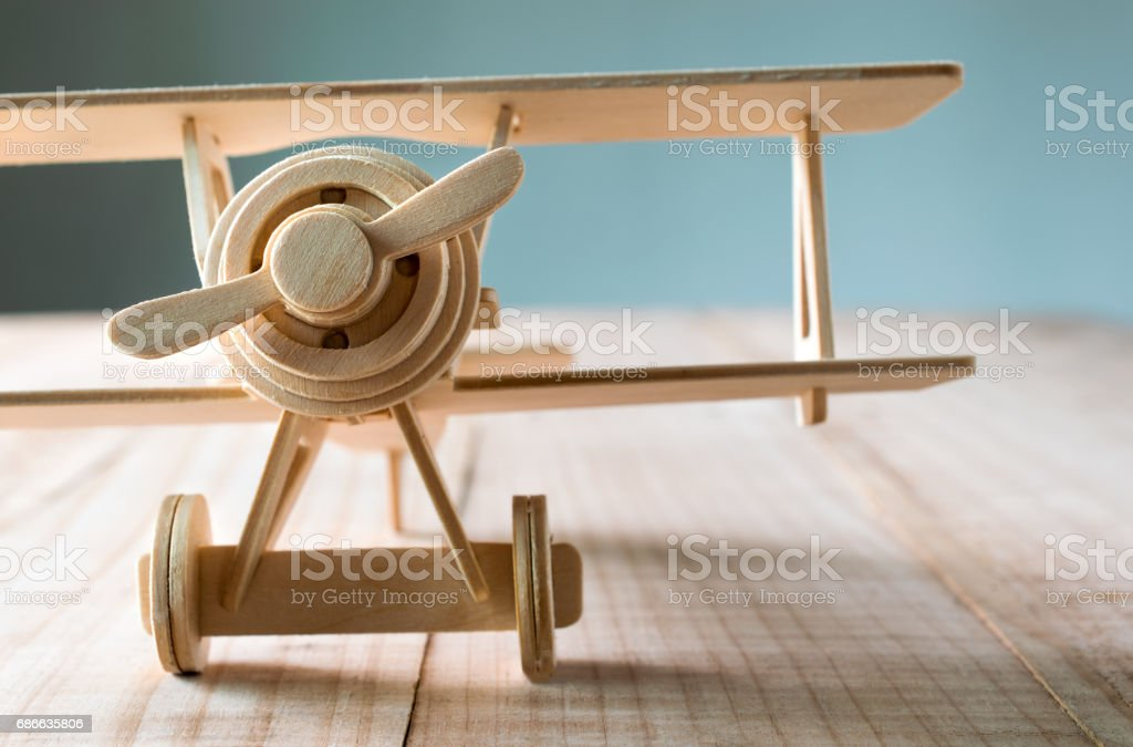 close up wood toy airplane on wood table . royalty-free stock photo