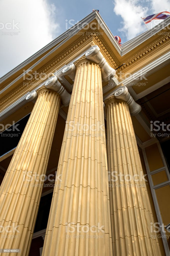 Close up shot of yellow painted architectural column design from a...