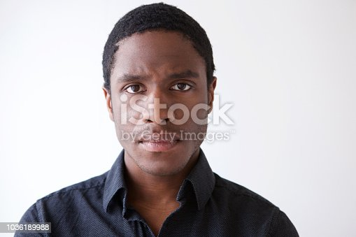 Close up horizontal portrait of young african american man staring