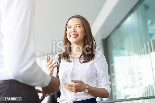 541975802 istock photo close up young beautiful officer woman talking about business future  with partner to explaining mission and vision of development and marketing in the global at outside conference room after finished meeting event  , collaboration of working  concept 1173455222