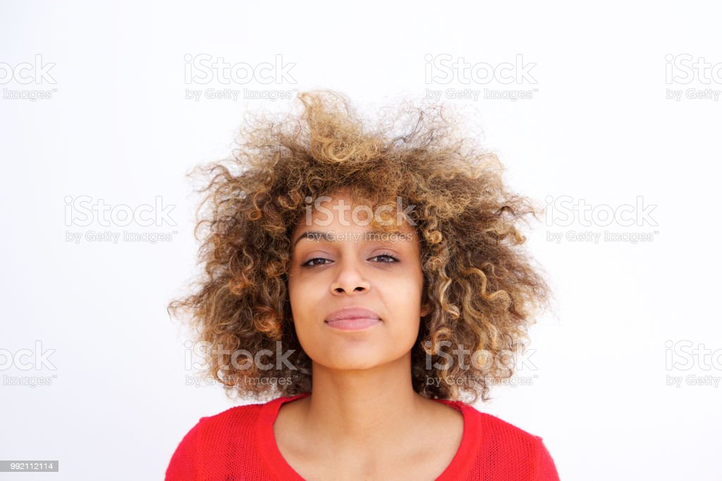Close up young black woman smirking against white backgorund stock photo