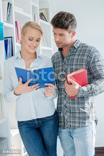 834814926 istock photo Close up Young Couple Reading Book 518423933