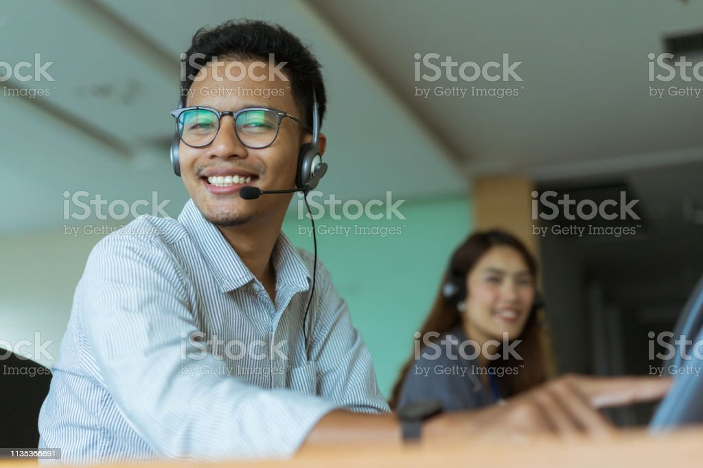 close up young employee man call center agent wear headset device...