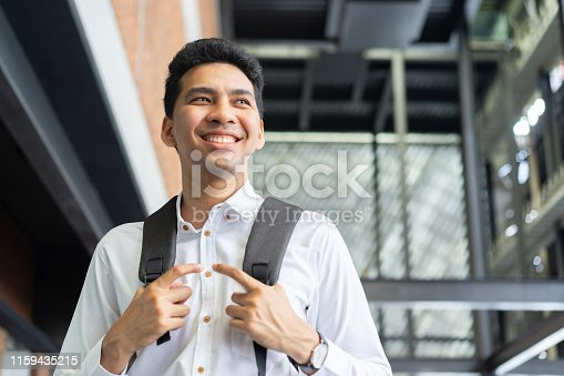 istock close up young handsome of muslim student asian man  carrying bag and looking forward with happy and confident feeling at library university campus , studying lifestyle concept 1159435215