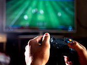 istock close up young man with joystick controller for console playing sport simulator video game on large screen 1012249304