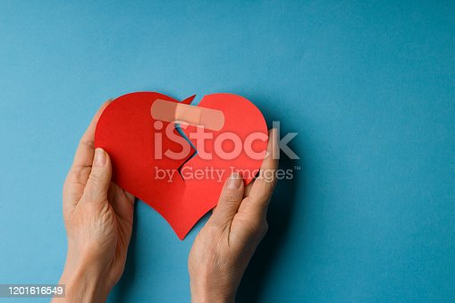 857308152 istock photo Close Up Young Woman Hand Holding Red Heart 1201616549