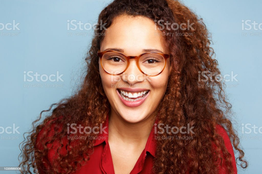Close Up Young Woman With Glasses And Curly Hair Smiling