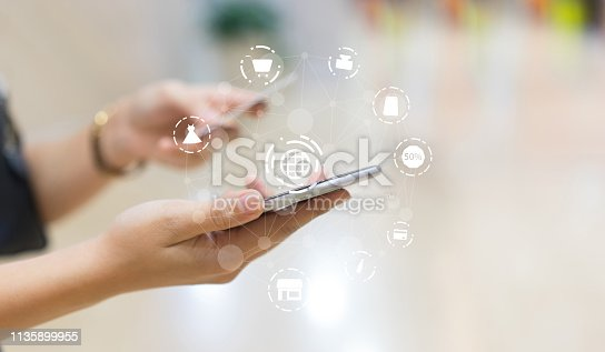close up young young woman using  smartphone and select item on marketplace website for shopping online in weekend with icon virtual interface technology concept
