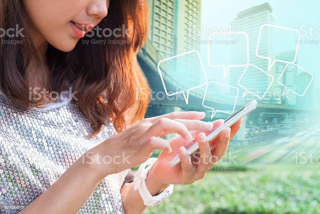close up younger woman touching on smart phone screen and stock photo