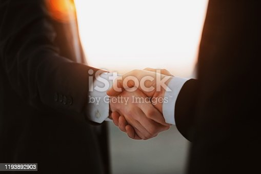 635949862 istock photo close up.business handshake over blurry background. 1193892903