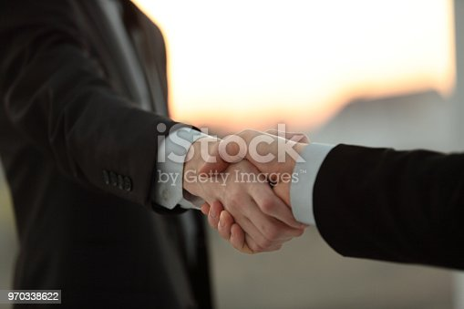 635949862 istock photo close up.business handshake over blurry background 970338622
