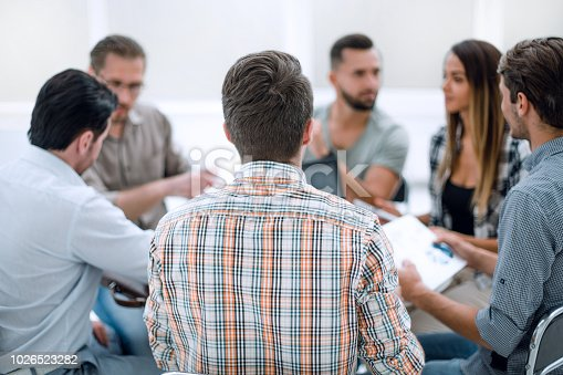 istock close up.business team discussing financial data 1026523282