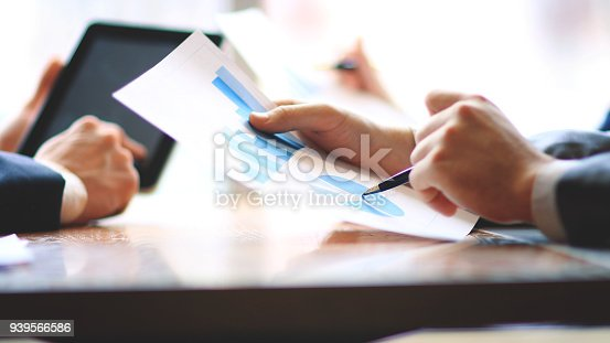close up.businessman and assistant checking financial report.
