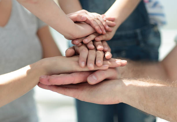 close up.family hands folded together stock photo
