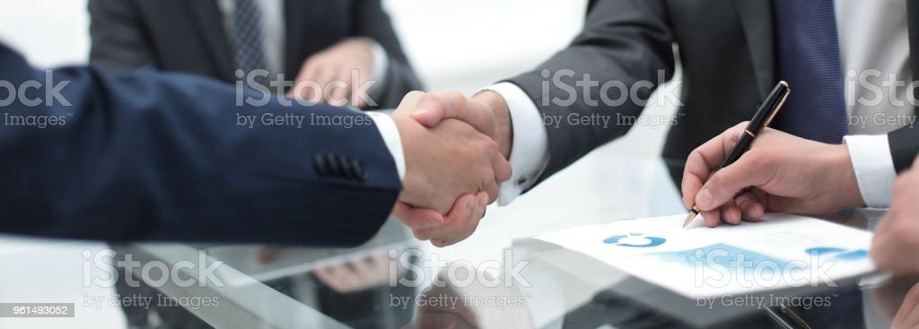 close up.handshake of business partners stock photo