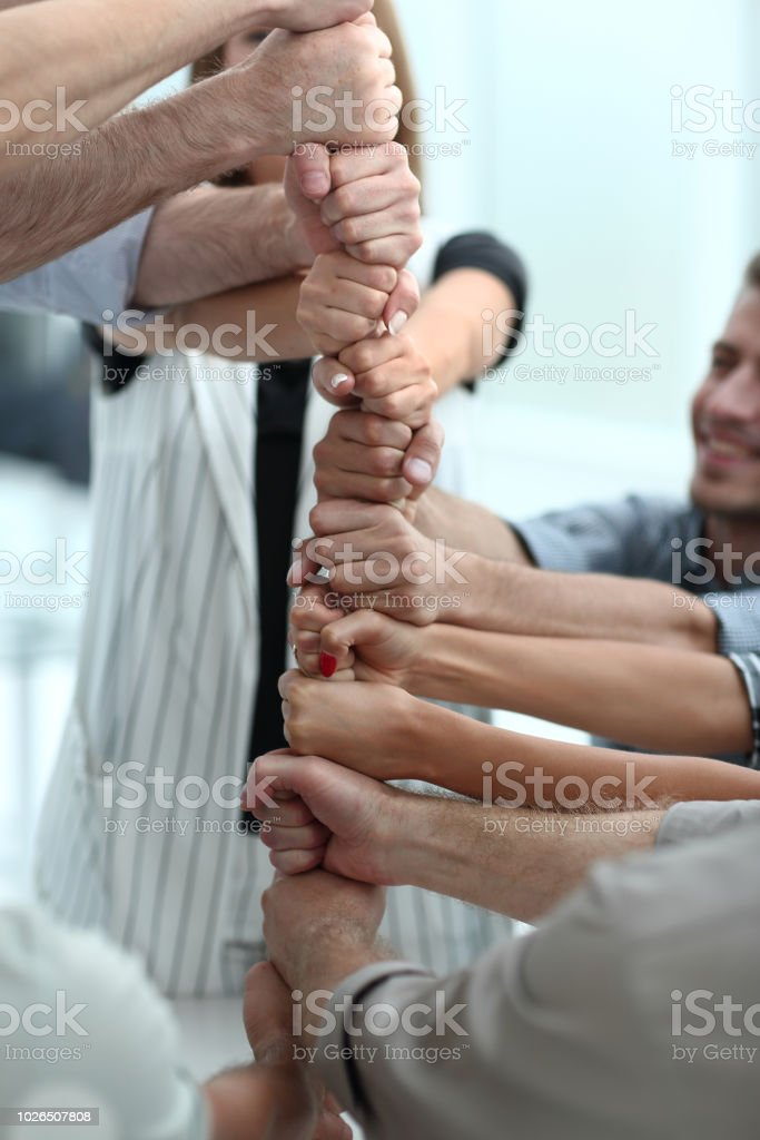close up.the business team is holding on to a strong rope stock photo