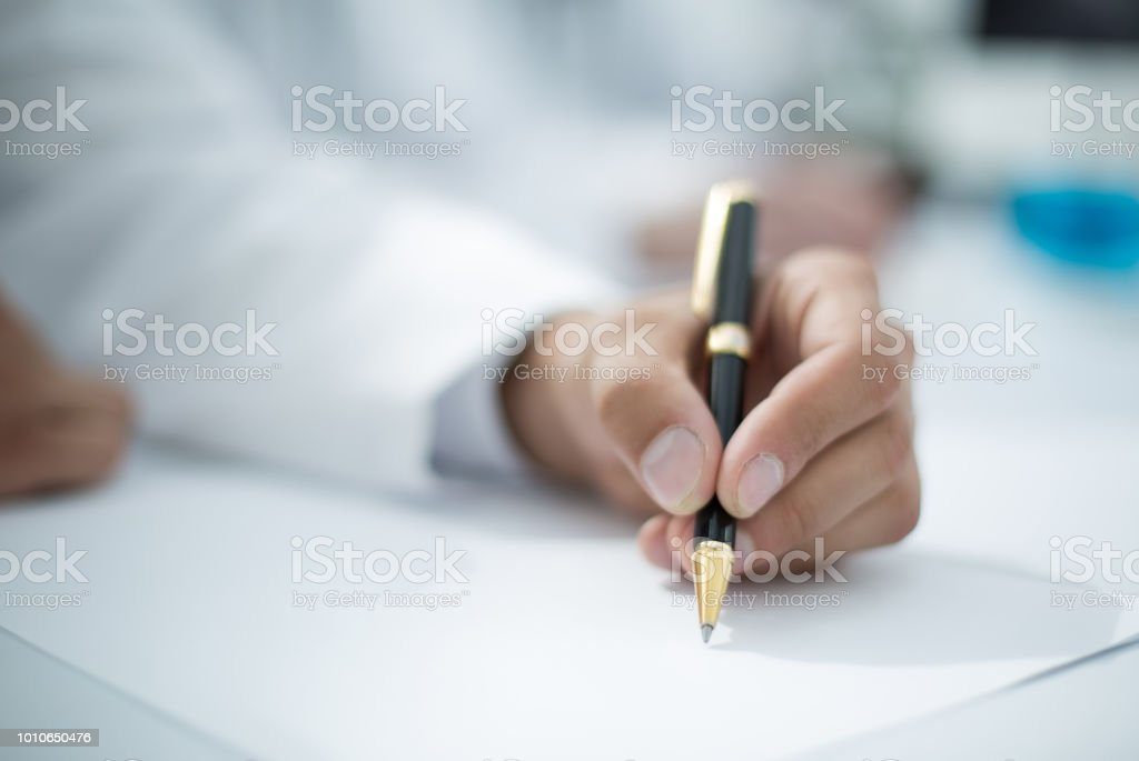 close up.the doctor writes a prescription stock photo