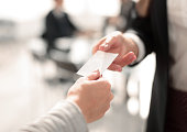 istock close up.two business woman exchanging business card 1022118974
