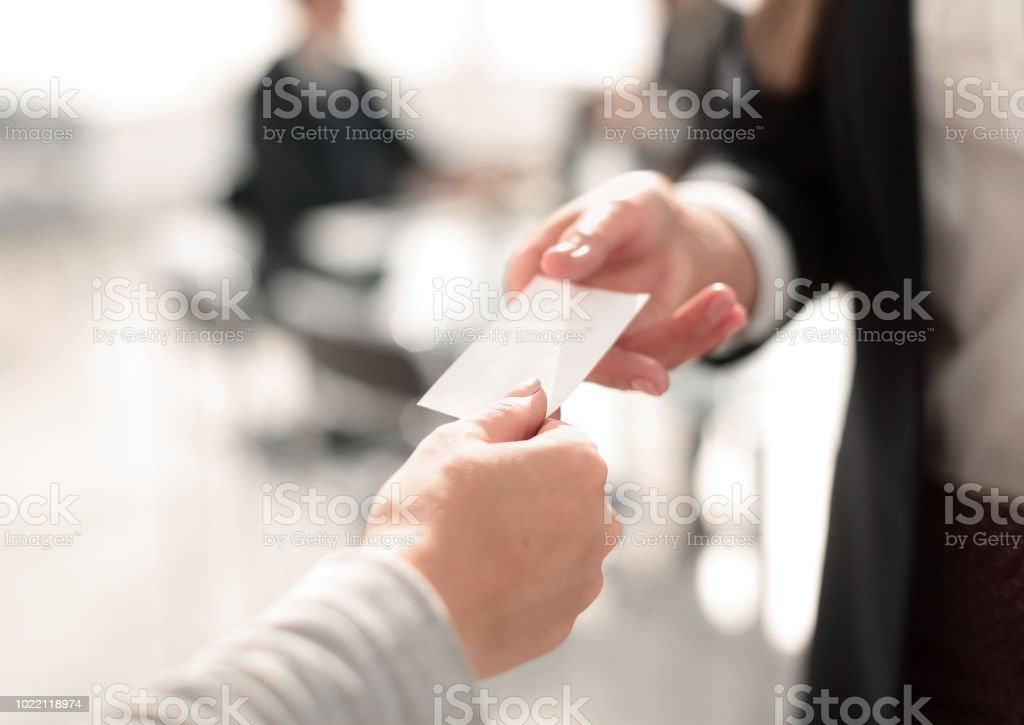 close up.two business woman exchanging business card stock photo