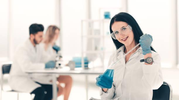 close up.woman scientist takes a sample of the liquid . - medical technology стоковые фото и изображения