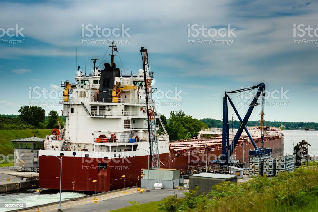 Close view of a Great Lakes Freight ship heading out of locks downward on the St. Lawrence River at Iroquois locks stock photo