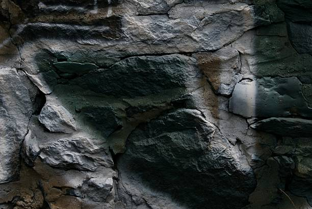close view of a rock wall reveals an easy beauty stock photo