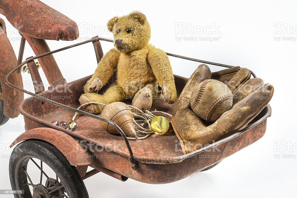 Close view of abandoned childhood toys stock photo