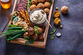 istock Close view of assorted meze appetizers beef, falafel, babaghanoush, potatoes in a box, copyspace. 1179124885