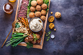 istock Close view of assorted meze appetizers beef, falafel, babaghanoush, potatoes in a box, copyspace. 1179124890