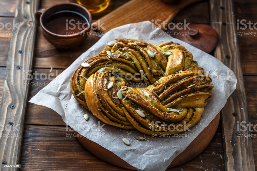 Close view of Babka Brioche Wreath with Pesto and Parmesan stock photo