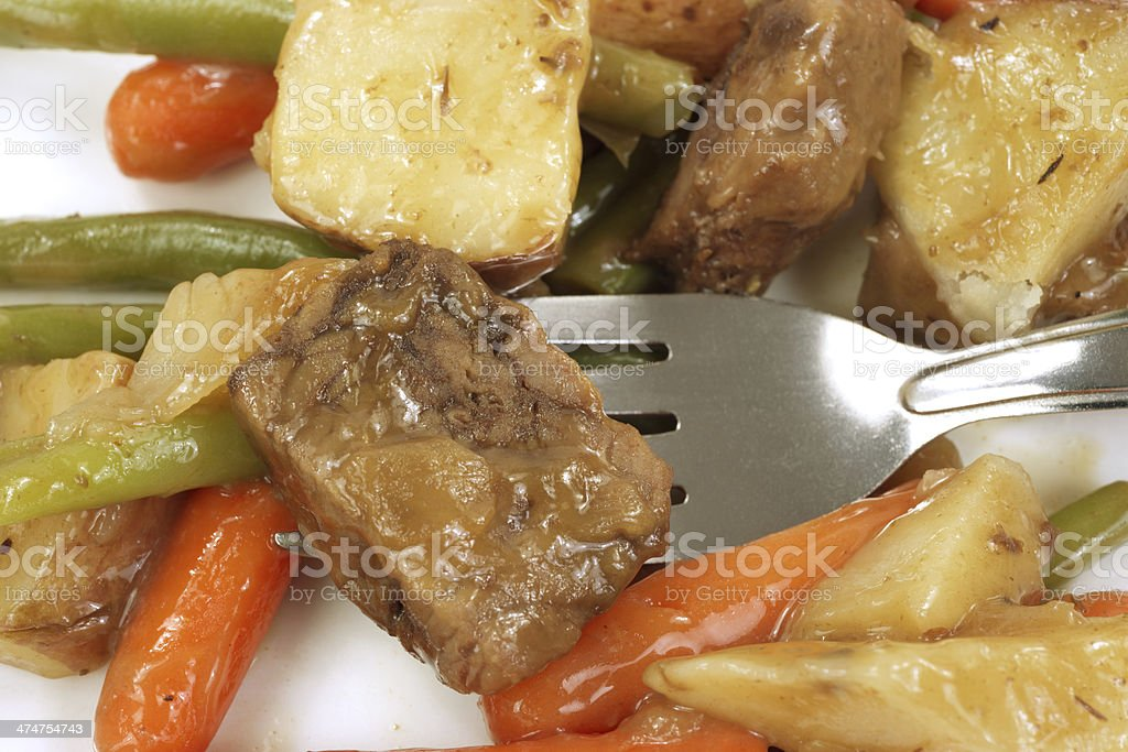 Close view of beef Merlot and vegetables with fork royalty-free stock photo