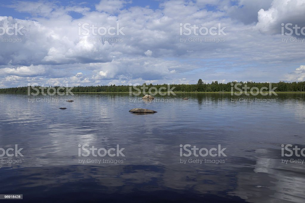 Close view of boulders in nothern lake royalty-free stock photo