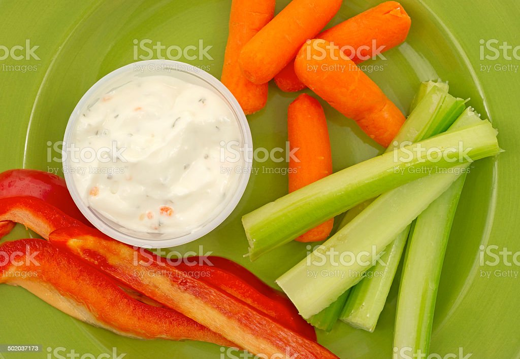 Close view of celery peppers carrots ranch dressing stock photo