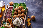 istock Close view of falafel, babaghanoush and pastrami in the wooden box, copyspace. 1179124882