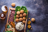 istock Close view of falafel, babaghanoush and pastrami in the wooden box, copyspace. 1179124897