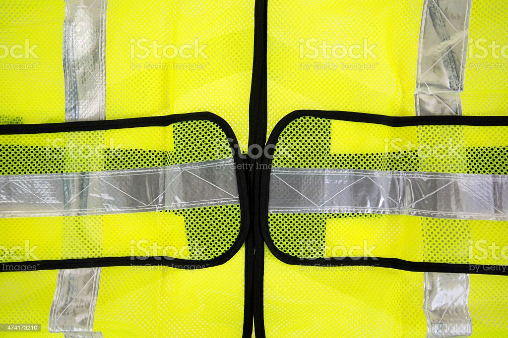 Close view of fluorescent yellow safety vest stock photo