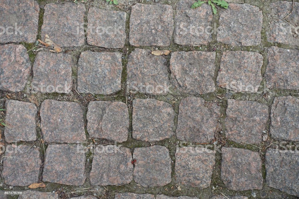 Close view of granite setts road pavement stock photo