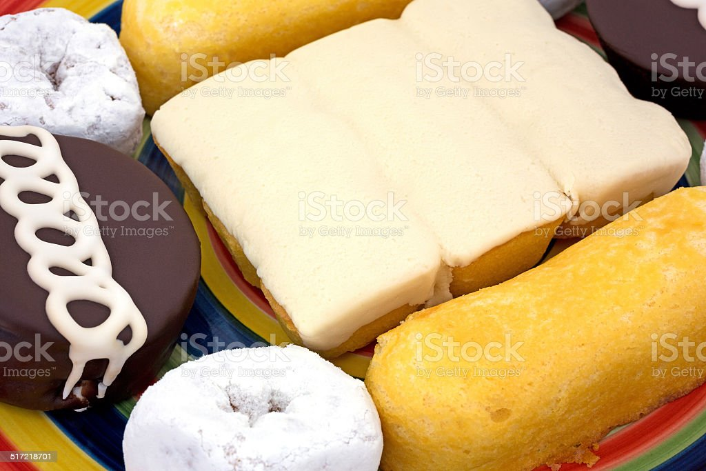 Close view of junk food cakes and donuts stock photo