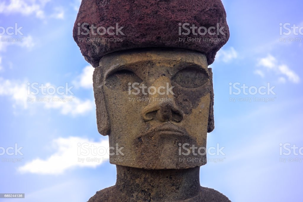 Close view of  Moai Statue Face of Ahu Nau Nau wearing topknot near Anakena Beach - Easter Island, Chile stock photo