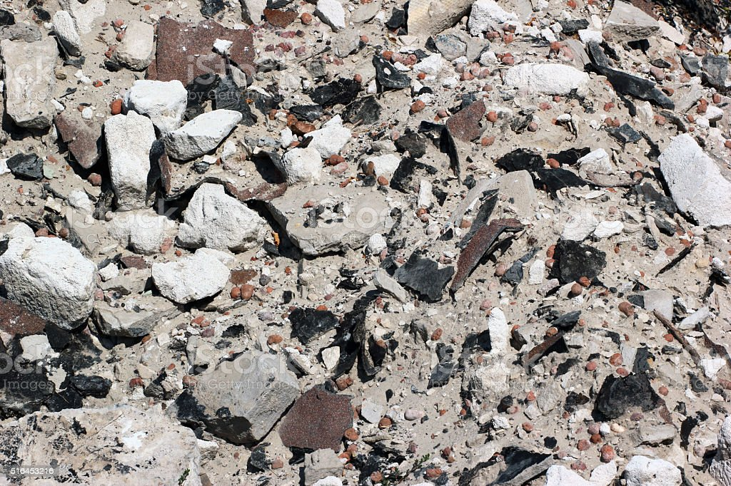 Close view of old construction debris and demolition waste. Sand stock photo