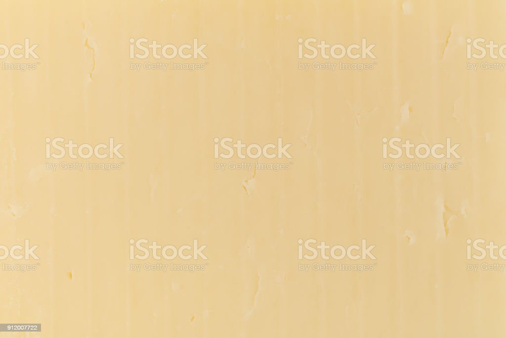 Close view of sharp cheddar cheese stock photo